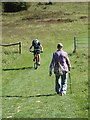 SU8018 : Cyclist and walker on the South Downs Way by Oliver Dixon