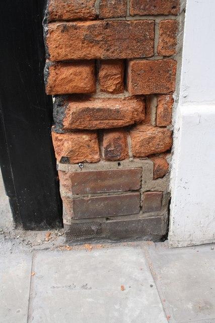 Damaged benchmark on #17 Sincil Street