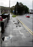 ST3090 : Puddles on a Malpas Road pavement, Newport by Jaggery