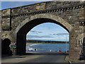 NJ5167 : Cullen Bay through the bridge on Seafield Street by Alan Murray-Rust