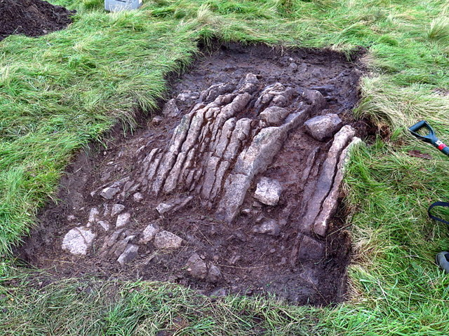 Excavating a stony mound, Fawdon Hill