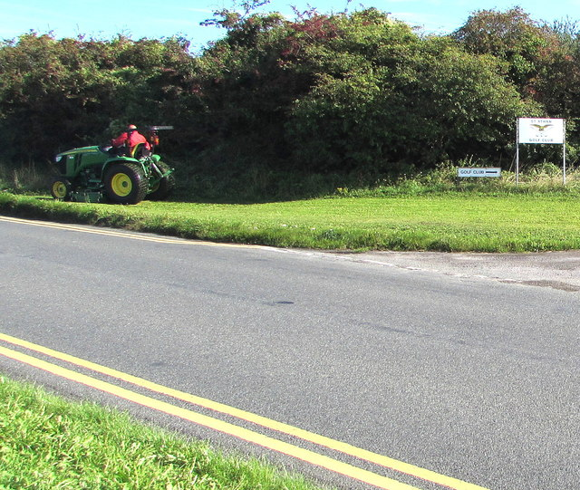 Grass cutting in progress on a St Athan corner