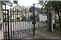 TL1696 : Impressive gates at entrance to #1 Grange Crescent by Luke Shaw