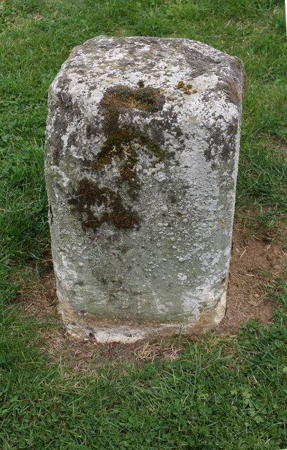 Old milestone with benchmark on south side of Oundle Road (A605)