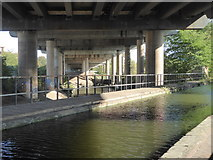 SP0990 : Canal, river and motorway by Chris Allen