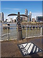 TQ3880 : Sustrans milepost, looking over the Thames to New Providence Wharflackwall by Tim Heaton