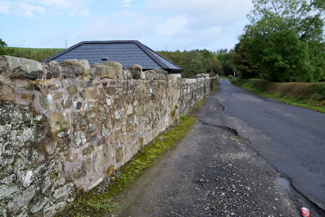 Stone built wall to front of Drumragh Graveyard