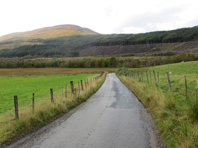 Fence-lined minor road heading in the direction of Inverlair