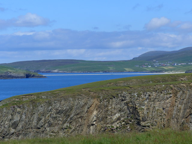 Zoom shot of cliff side across Punds Geo and Trei Geo, Northern Ness, Scousburgh