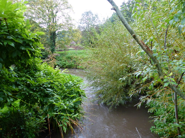 River Salwarpe from bridge in Webbs of Wychbold's decorative garden