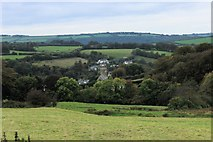 SS6644 : Distant view of Parracombe from the east by Martin Tester