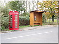 TL9331 : Telephone Box & Bus Shelter on the B1508 Main Road by Adrian Cable