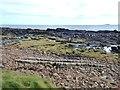 NO5905 : Rocky shoreline near the Coves by Oliver Dixon