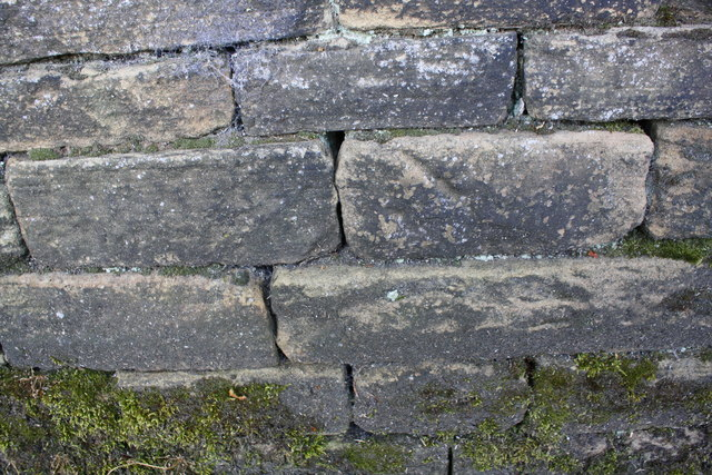 Benchmark on wall on southwest side of Cemetery Lane