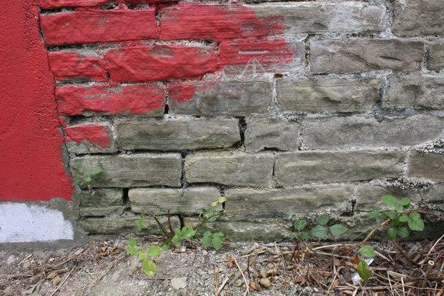 Benchmark on wall beside riverbank footpath near Huntingdon Road overbridge