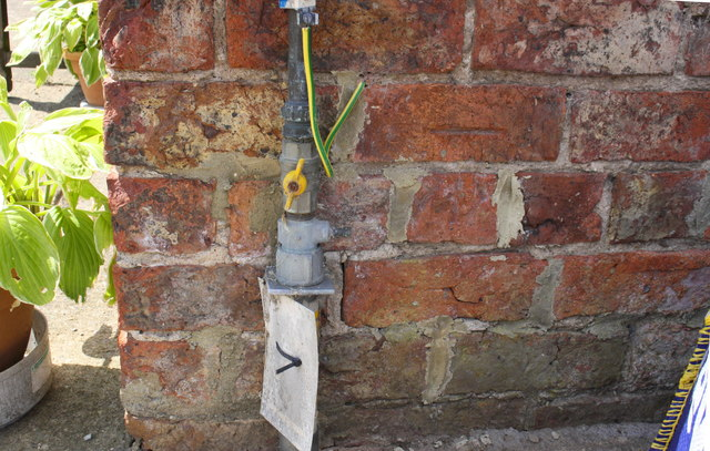 Benchmark on outbuilding at Brompton Banks