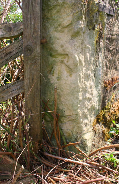 Benchmark on stone post at south end of east parapet of Hallikeld Bridge