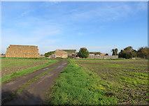 TL4352 : Bales and barns near Hauxton Mill by John Sutton