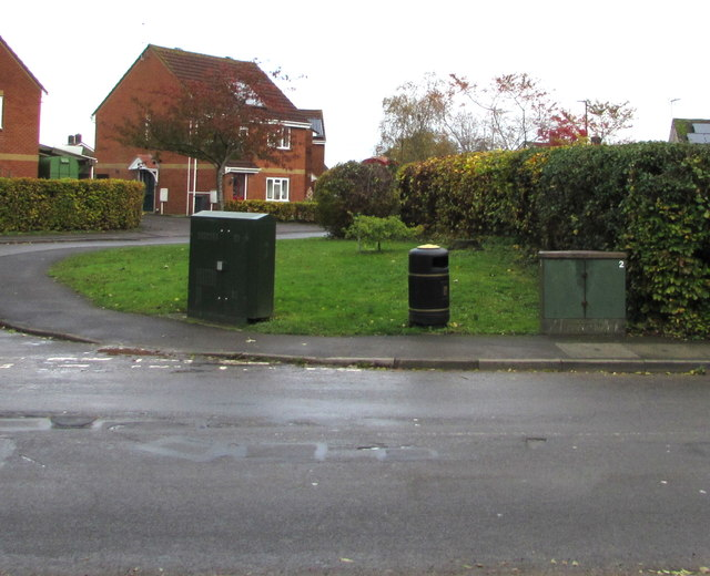 Two cabinets and a litter bin on a Whitminster corner