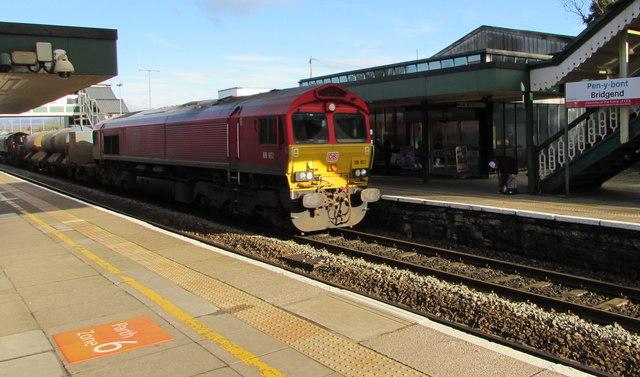 Class 66 diesel locomotive passing through Bridgend station