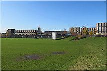TL4259 : Eddington: sightscreen and Sainsbury's by John Sutton