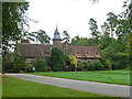 SS9615 : Knightshayes Court - the stable block by Chris Allen