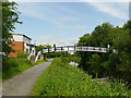 NS5767 : Footbridge from Maryhill Road by Stephen Craven
