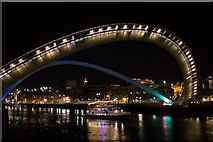 NZ2563 : Night view of the Millennium Bridge tilting for the Fortuna party boat by Mark Anderson