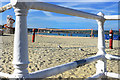 SY6878 : Beach Volleyball through the Railings by Des Blenkinsopp