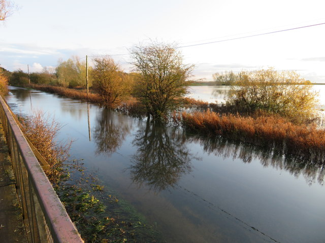 Reflections on the road at Sutton Gault - The Ouse Washes