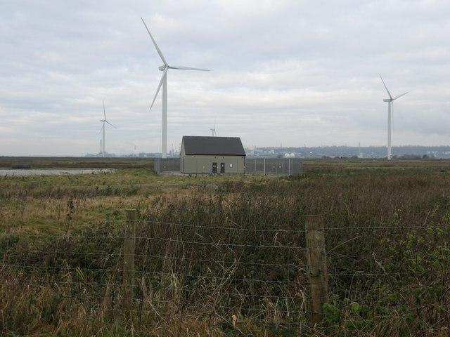 Building and four wind turbines, Frodsham wind farm