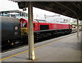 ST1875 : Diesel locomotive travelling west through Cardiff Central station by Jaggery