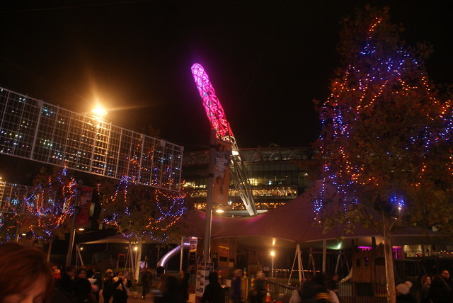 View of the Wembley Stadium arch and illuminated trees at Wembley Winterfest