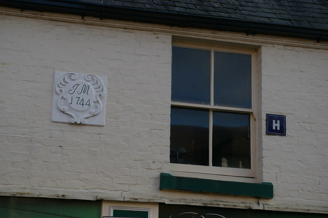 Plaque and sign on a shop, Beatrice Street, Oswestry