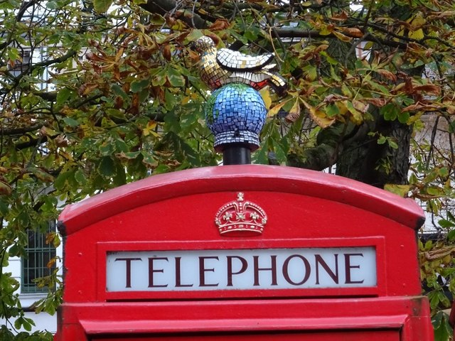 Pigeon finial on a telephone box