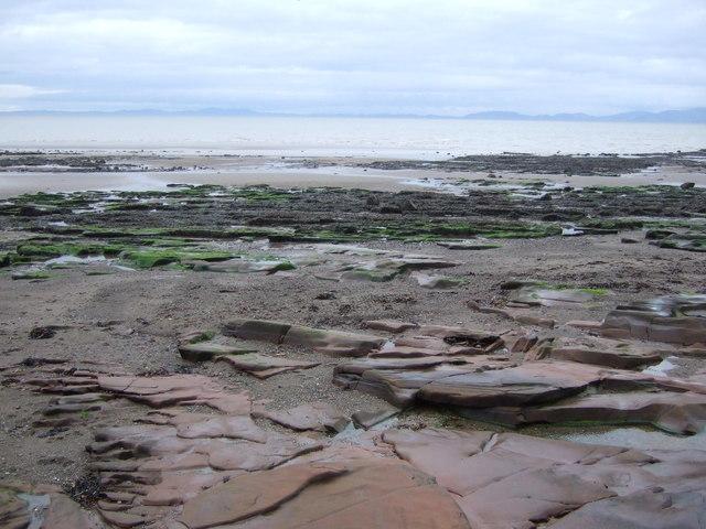 Rocks and beach near Maryport by JThomas