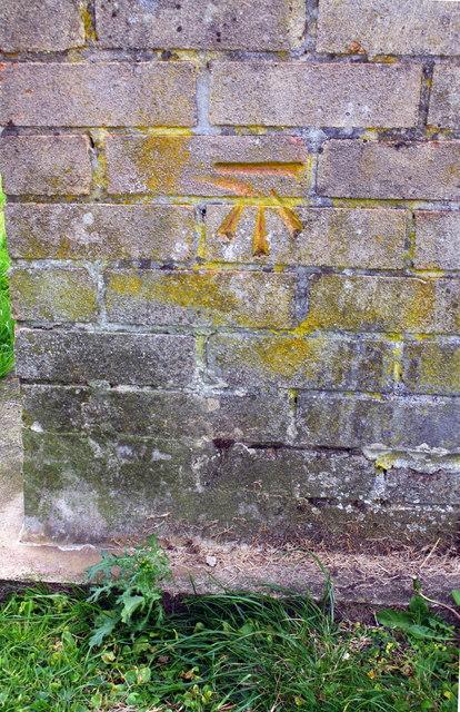 Benchmark on Weymouth Close garage block