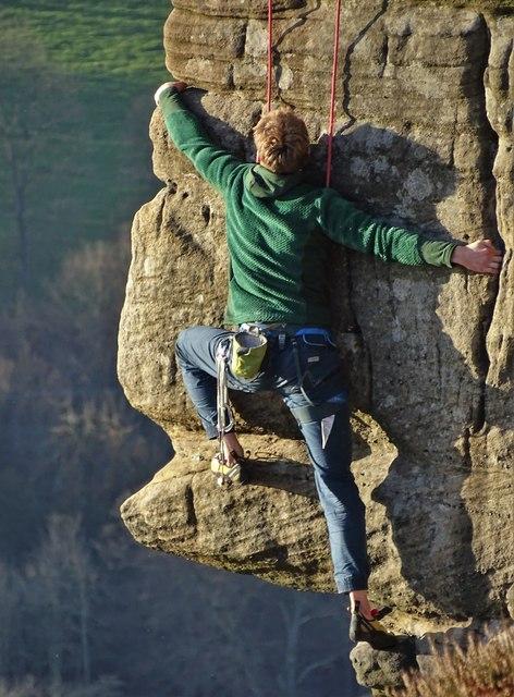 Rock climber above Froggatt