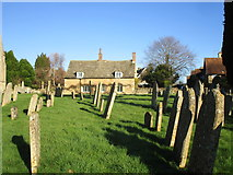 TL0394 : Churchyard and cottage, Woodnewton by Jonathan Thacker