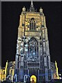 TG2208 : Light projections on the tower of St Peter Mancroft church by Evelyn Simak
