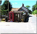 SS9843 : Grade II Listed red phonebox on a Dunster corner by Jaggery
