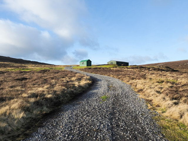 Two shooting huts and a hill road