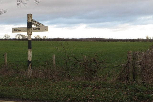 Field and old signpost by Ecton Lane
