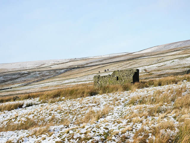 Ruin on thinly snowed moorland