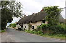 SU2560 : Thatched cottage on Grafton Road, East Grafton by David Howard