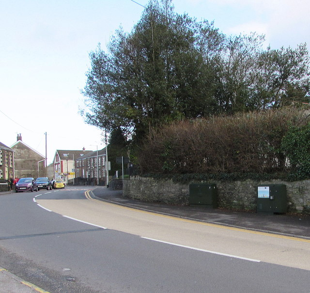 Two dark green cabinets alongside Main Road, Crynant