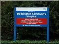 TL3990 : Doddington Community Hospital sign by Adrian Cable