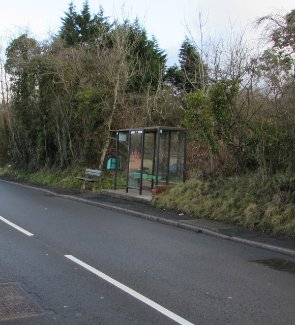 Bus shelter and a bench alongside the A4109 Dulais Road, Seven Sisters