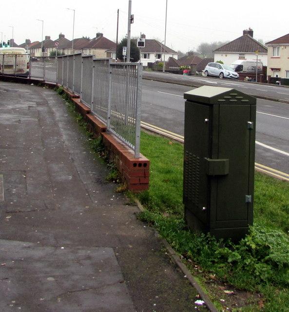 Dark green cabinet on grass above Malpas Road, Newport