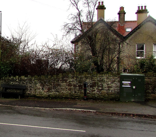 Telecoms cabinet and a bench, Templeway West, Lydney
